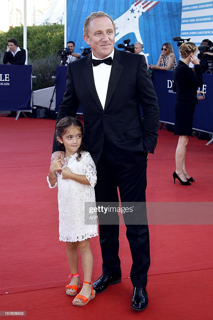 Salma Hayek's husband and French luxury and retail group PPR Chairman and CEO Francois-Henri Pinault poses on the red carpet with his daughter Valentina as she arrives to attend the awarding ceremony off the 38th Deauville's US Film Festival on September 8, 2012 in the French northwestern sea resort of Deauville.