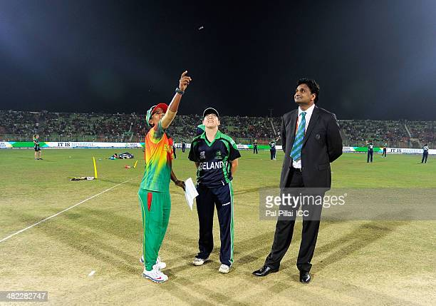 Salma Khatun captain of Bangladesh Isobel Joyce captain of Ireland and ICC match referee Javagal Srinath during the toss before the start of the ICC...