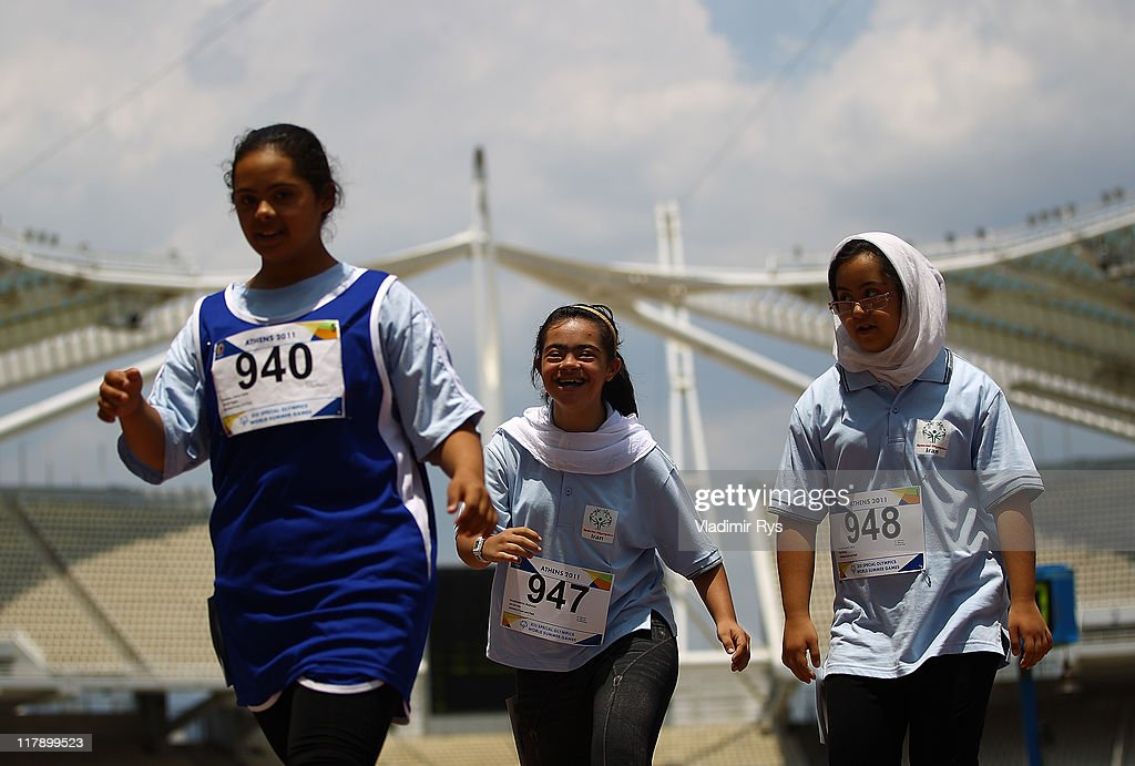 Salma Talaat Shabana of Egypt, Reyhaneh Serajiantabrizi and Zahra Shoushanzadeh both of Iran are pictured after competing at the 100 meters run of the Athens 2011 Special Olympics World Summer Games on July 1, 2011 in Athens, Greece.