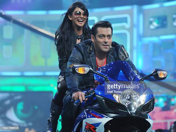 Salman Khan and Sakshi Pradhan perform at the first episode of the reality show Bigg Boss 4 in Mumbai on October 3 2010