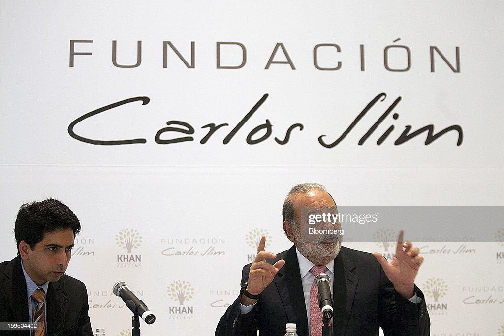 Salman Khan, founder of the Khan Academy, left, listens during a news conference with Mexican billionaire <a gi-track='captionPersonalityLinkClicked' href=/galleries/search?phrase=Carlos+Slim&family=editorial&specificpeople=584959 ng-click='$event.stopPropagation()'>Carlos Slim</a> in Mexico City, Mexico, on Monday, Jan. 14, 2013. Slim announced his support for Khan's not-for-profit website that offers free educational videos and teaching tools. Photographer: Susana Gonzalez/Bloomberg via Getty Images