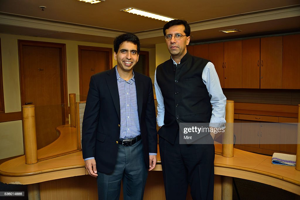 Salman Khan, the promoter of US based Khan Academy, with Ashish Dhawan, Indian private equity investor and philanthropist, pose during an exclusive interview at India Habitat Centre on December 3, 2015 in New Delhi, India.