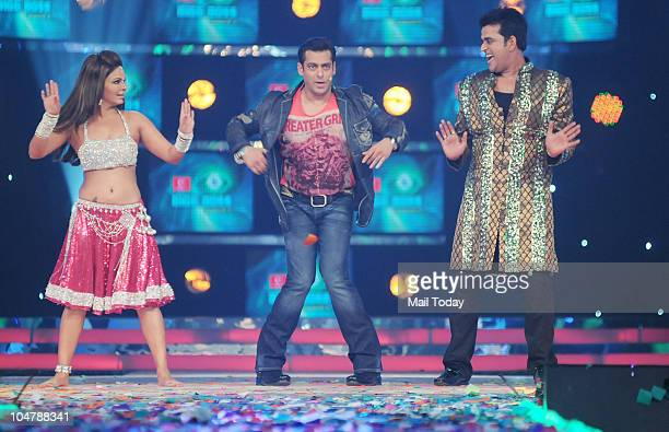 Salman Khan Rakhi Sawant and Ravi Kishen perform at the first episode of the reality show Bigg Boss 4 in Mumbai on October 3 2010