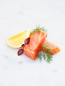 Salmon and lemon on white background