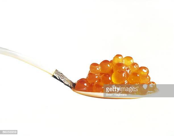 Salmon caviar on spoon