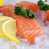 Red norway salmon filet on crushed ice