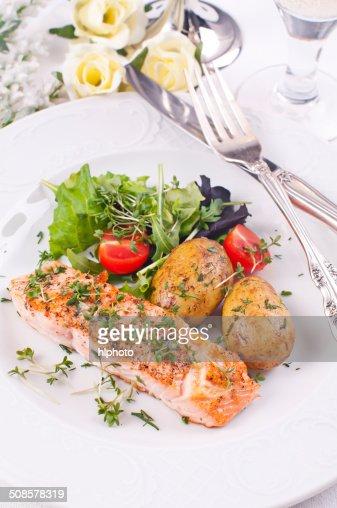 Salmon Filet with Potato and Salad : Stock Photo