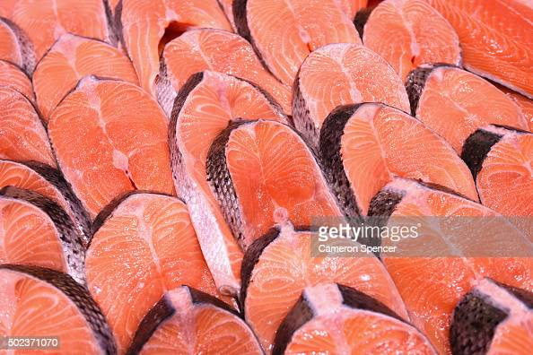 Salmon fillets are seen as crowds gather for last minute shopping before Christmas at the Sydney Fish Market on December 24 2015 in Sydney Australia...