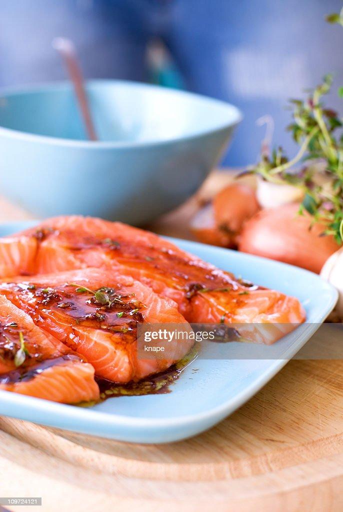 Salmon in marinade : Stock Photo