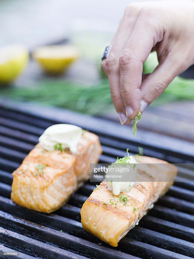 Salmon on a barbecue close-up Sweden. : Stock Photo