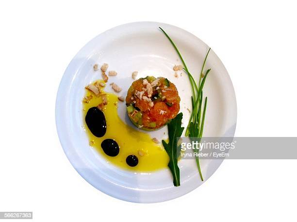 Salmon Salad And Sauce Served In Plate Over White Background