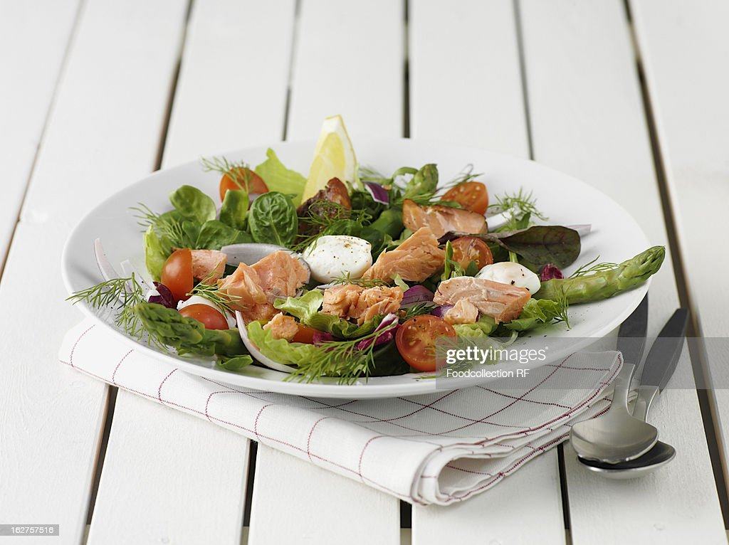 Salmon salad with cherry tomatoes : Stock Photo