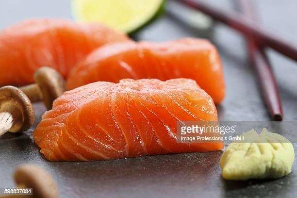 Salmon sashimi, wasabi and mushrooms