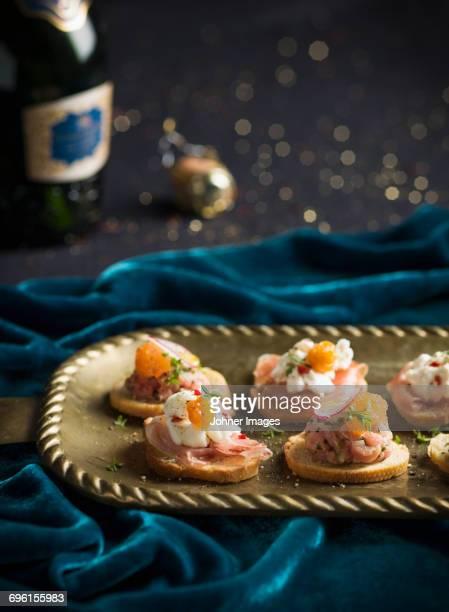 Salmon snacks on tray