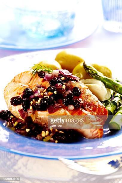 Salmon steak baked with raisins
