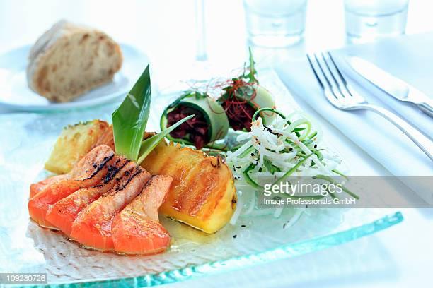 Salmon with teriyaki sauce on plate