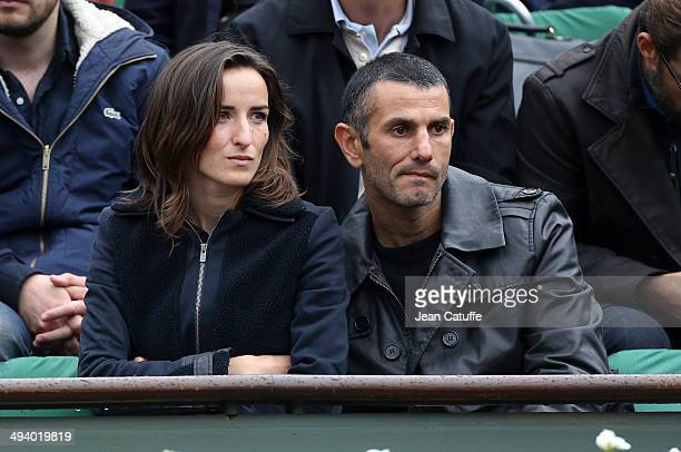 Salome Stevenin and Stephane Mifsud attend the Roland Garros French Tennis Open 2014 Day 2 on May 26 2014 in Paris France