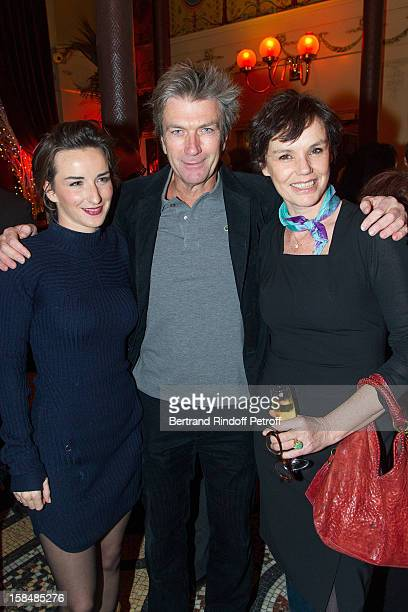 Salome Stevenin Philippe Carroy and Claire Nebout pose at restaurant Le Grand Colbert on December 17 2012 in Paris France
