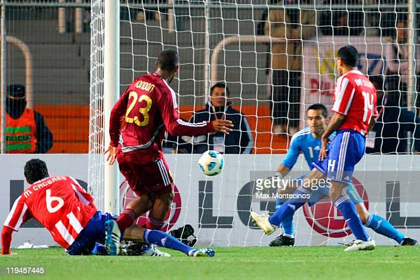 Salomón Rondón from Venezuela fights for the ball against Marcos Cáceres from Paraguay during a semi final match between Paraguay and Venezuela at...