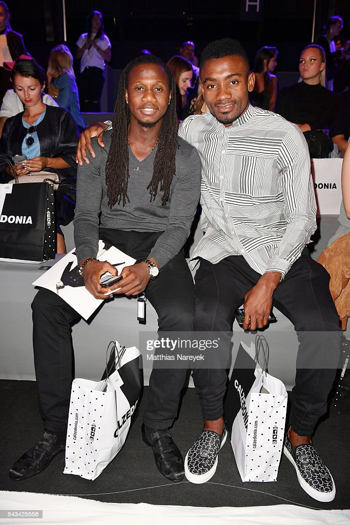 Salomon Kalou (R) and a guest attend the Odeur show during the Mercedes-Benz Fashion Week Berlin Spring/Summer 2017 at Erika Hess Eisstadion on June 28, 2016 in Berlin, Germany.