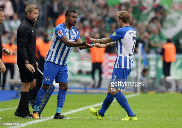 Salomon Kalou and Alexander Esswein of Hertha BSC during the game between Hertha BSC and Werder Bremen on September 10 2017 in Berlin Germany