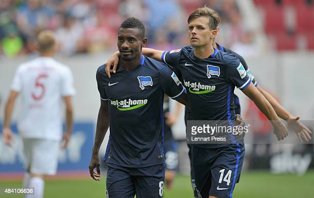 Salomon Kalou and Valentin Stocker of Hertha BSC celebrate the opening goal during the Bundesliga match between FC Augsburg and Hertha BSC at...