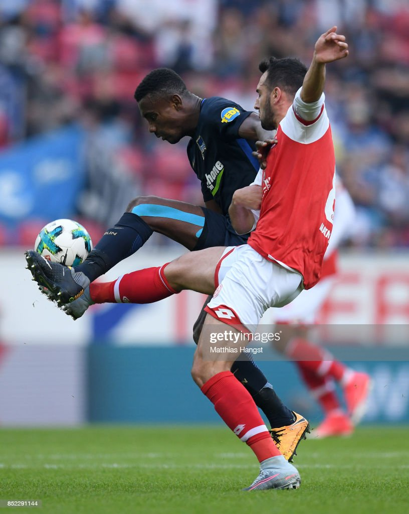 Salomon Kalou of Berlin and Mete Levin Oeztunali of Mainz compete for the ball during the Bundesliga match between 1. FSV Mainz 05 and Hertha BSC at Opel Arena on September 23, 2017 in Mainz, Germany.