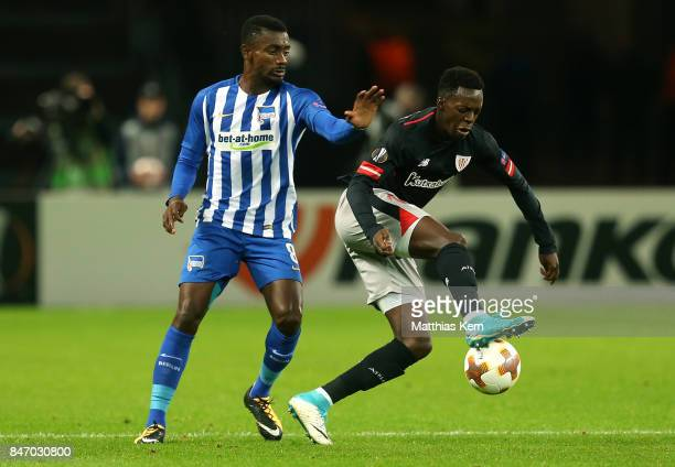 Salomon Kalou of Berlin battles for the ball with Inaki Williams of Bilbao during the UEFA Europa League group J match between Hertha BSC and...