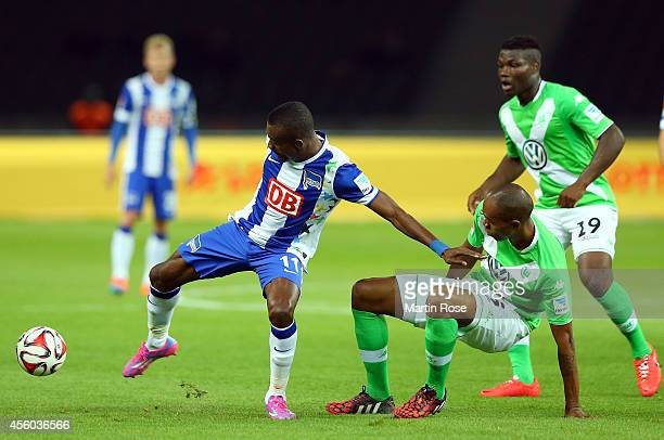 Salomon Kalou of Berlin battles for the ball with Naldo of Wolfsburg during the Bundesliga match between Hertha BSC and VfL Wolfsburg at...