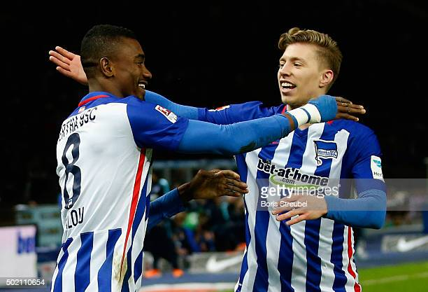 Salomon Kalou of Berlin celebrates after scoring his team's second goal with team mate Mitchell Weiser during the Bundesliga match between Hertha BSC...