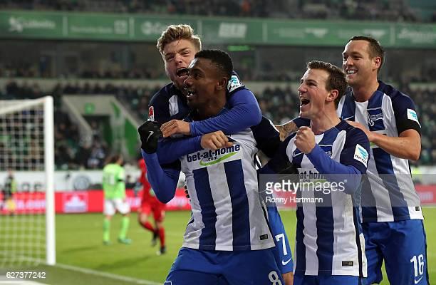Salomon Kalou of Berlin celebrates after scoring his team's third goal with Alexander Esswein Vladimir Darida and Julian Schieber of Berlin during...