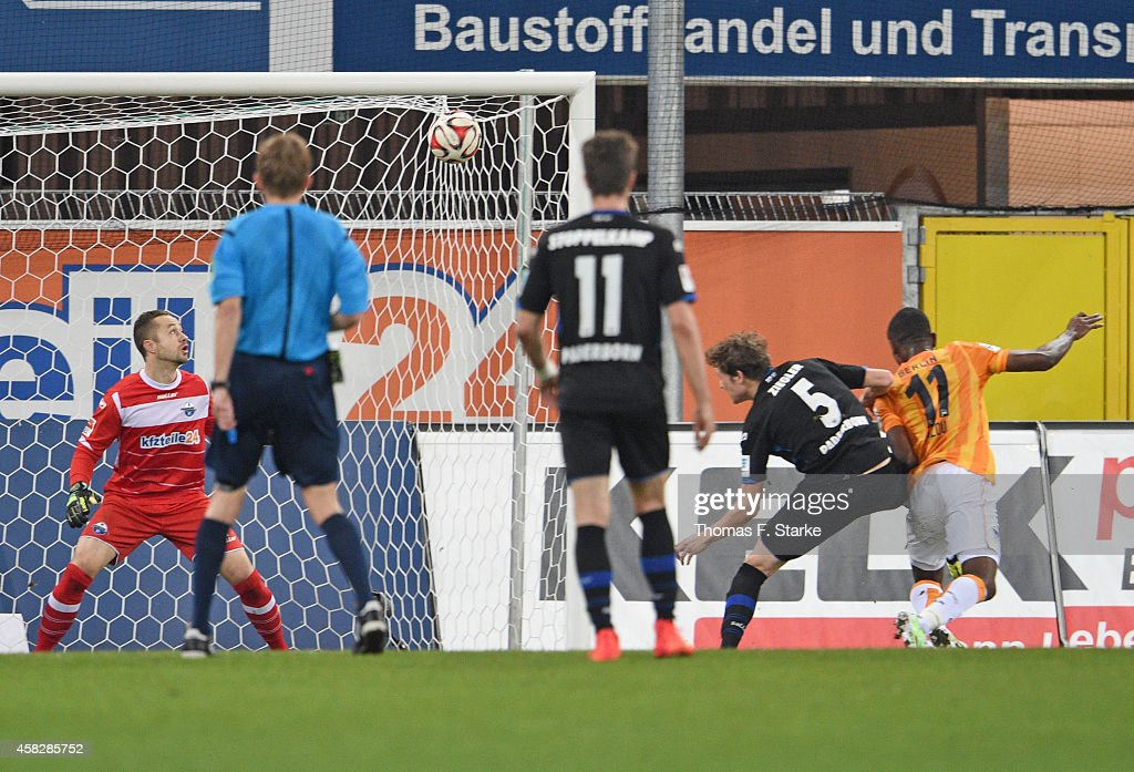 Salomon Kalou of Berlin scores his teams first goal against Lukas Kruse and Patrick Ziegler of Paderborn during the Bundesliga match between SC...