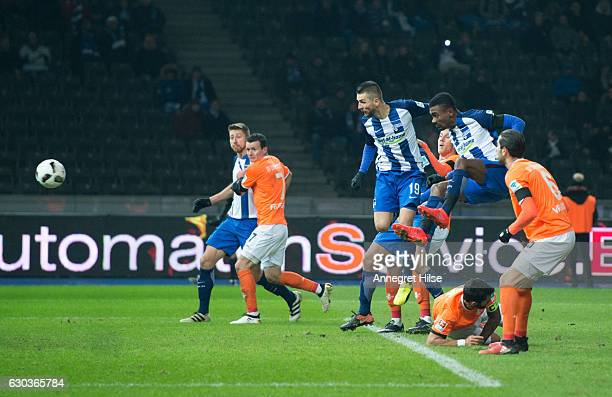 Salomon Kalou of Berlin scores to the second goal for his team against Mario Vrancic and Aytac Sulu of Darmstadt during the Bundesliga match between...