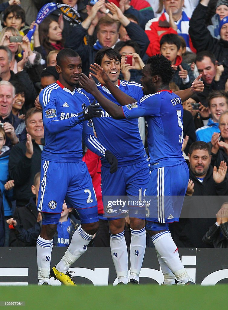 <a gi-track='captionPersonalityLinkClicked' href=/galleries/search?phrase=Salomon+Kalou&family=editorial&specificpeople=453312 ng-click='$event.stopPropagation()'>Salomon Kalou</a> (L) of Chelsea celebrates Chelsea's second goal with team mates <a gi-track='captionPersonalityLinkClicked' href=/galleries/search?phrase=Paulo+Ferreira+-+Soccer+Player&family=editorial&specificpeople=185237 ng-click='$event.stopPropagation()'>Paulo Ferreira</a> and <a gi-track='captionPersonalityLinkClicked' href=/galleries/search?phrase=Michael+Essien&family=editorial&specificpeople=523500 ng-click='$event.stopPropagation()'>Michael Essien</a> (R) during the Barclays Premier League match between Chelsea and Wolverhampton Wanderers at Stamford Bridge on October 23, 2010 in London, England.