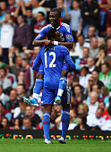 Salomon Kalou of Chelsea celebrates with John Obi Mikel as scores their second goal during the Barclays Premier League match between West Ham United...
