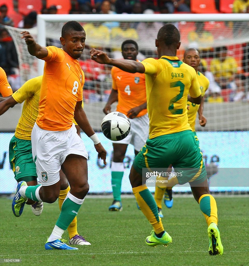 Salomon Kalou of Cote D'Ivoire and Siboniso Gaxa of Bafana Bafana in action during the Nelson Mandela Challenge match between South Africa and Ivory...