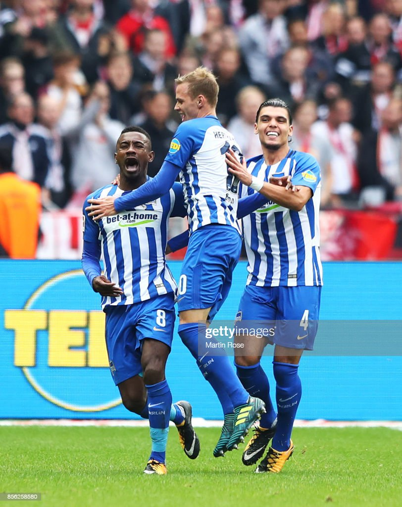 Salomon Kalou of Hertha Berlin celebrates with Ondrej Duda of Hertha Berlin after a scoring goal during the Bundesliga match between Hertha BSC and FC Bayern Muenchen at Olympiastadion on October 1, 2017 in Berlin, Germany.