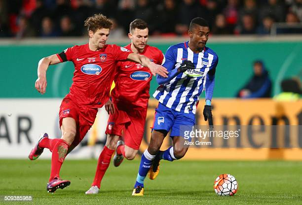 Salomon Kalou of Hertha Berlin is pursued by Sami Allagui and Niklas Stark of Hertha Berlin during the DFB Cup quarter final match between 1 FC...