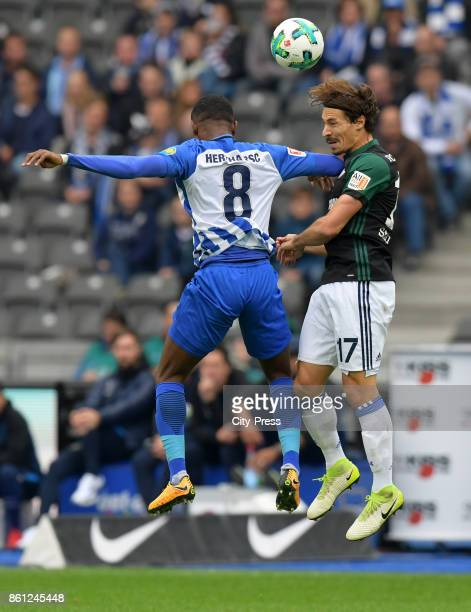 Salomon Kalou of Hertha BSC and Benjamin Stambouli of FC Schalke 04 during the game between Hertha BSC and Schalke 04 on october 14 2017 in Berlin...