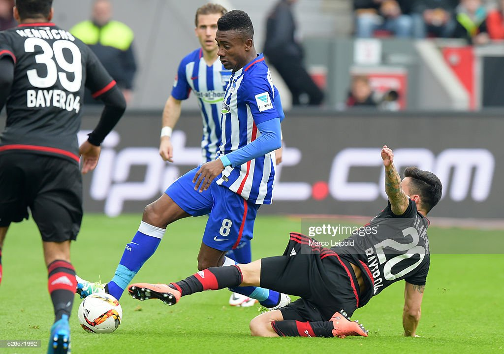 Salomon Kalou of Hertha BSC and Charles Ar����nguiz of Bayer 04 Leverkusen during the game between Bayer 04 Leverkusen and Hertha BSC on april 30, 2016 in Leverkusen, Germany.