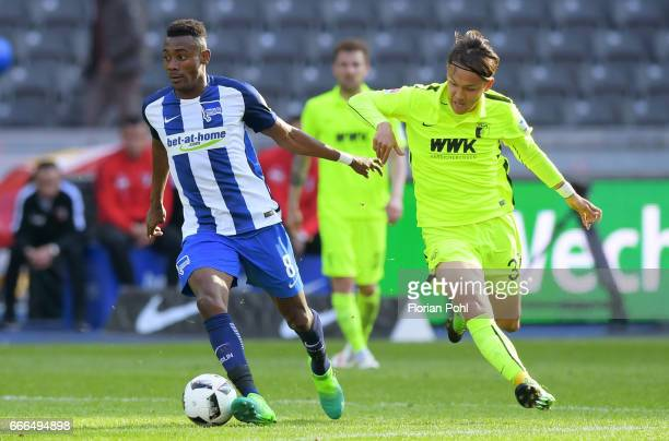 Salomon Kalou of Hertha BSC and Takashi Usami of FC Augsburg during the game between Hertha BSC and FC Augsburg on April 9 2017 in Berlin Germany