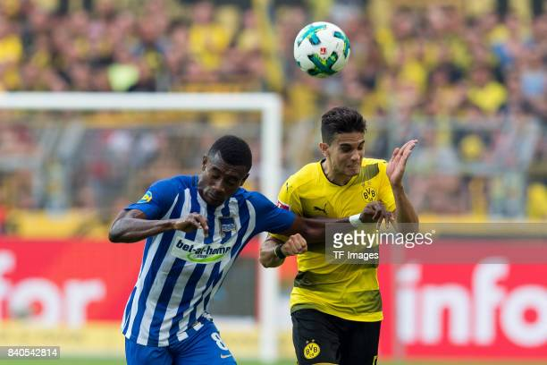 Salomon Kalou of Hertha BSC Berlin and Marc Bartra of Dortmund battle for the ball during the Bundesliga match between Borussia Dortmund and Hertha...