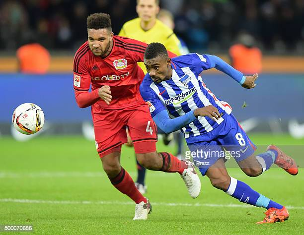 Salomon Kalou of Hertha BSC handles the ball against Jonathan Tah of Bayer 04 Leverkusen during the game between Hertha BSC and Bayer 04 Leverkusen...