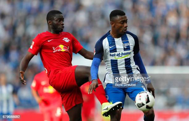 Salomon Kalou of Hertha BSC is challenged by Dayot Upamecano of RB Leipzig during the Bundesliga match between Hertha BSC and RB Leipzig at...