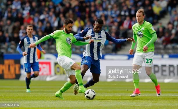 Salomon Kalou of Hertha BSC is challenged by Yunus Malli of VfL Wolfsburg during the Bundesliga match between Hertha BSC and VfL Wolfsburg at...