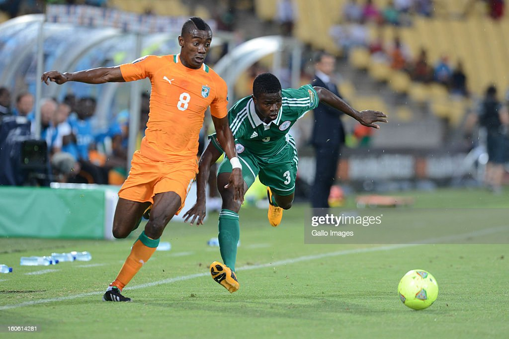 <a gi-track='captionPersonalityLinkClicked' href=/galleries/search?phrase=Salomon+Kalou&family=editorial&specificpeople=453312 ng-click='$event.stopPropagation()'>Salomon Kalou</a> of Ivory Coast and Elderson Echiejile of Nigeria during the 2013 Orange African Cup of Nations 3rd Quarter Final match between Ivory Coast and Nigeria at Royal Bafokeng Stadium on February 03, 2013 IN Rustenburg, South Africa.