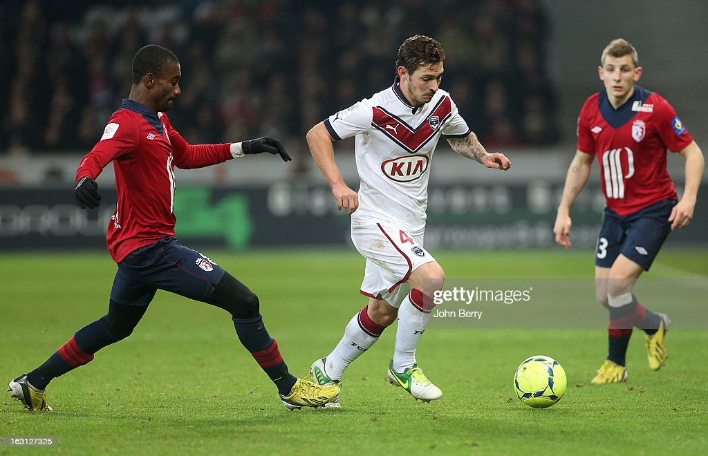 <a gi-track='captionPersonalityLinkClicked' href=/galleries/search?phrase=Salomon+Kalou&family=editorial&specificpeople=453312 ng-click='$event.stopPropagation()'>Salomon Kalou</a> of Lille and <a gi-track='captionPersonalityLinkClicked' href=/galleries/search?phrase=Ludovic+Obraniak&family=editorial&specificpeople=661174 ng-click='$event.stopPropagation()'>Ludovic Obraniak</a> of Bordeaux in action during the french Ligue 1 match between Lille LOSC and FC Girondins de Bordeaux at the Grand Stade Lille Metropole on March 3, 2013 in Lille, France.