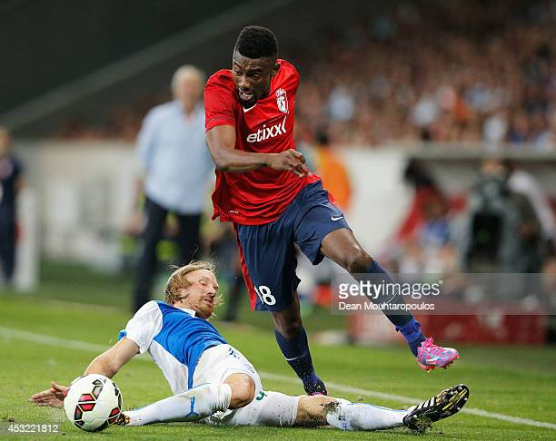 Salomon Kalou of Lille and Michael Lang of Grasshopper battle for the ball during the UEFA Champions League third qualifying round 2nd leg match...