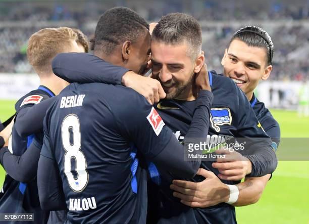 Salomon Kalou Vedad Ibisevic and Karim Rekik of Hertha BSC celebrate after scoring the 01 during the game between VfL Wolfsburg and Hertha BSC on...