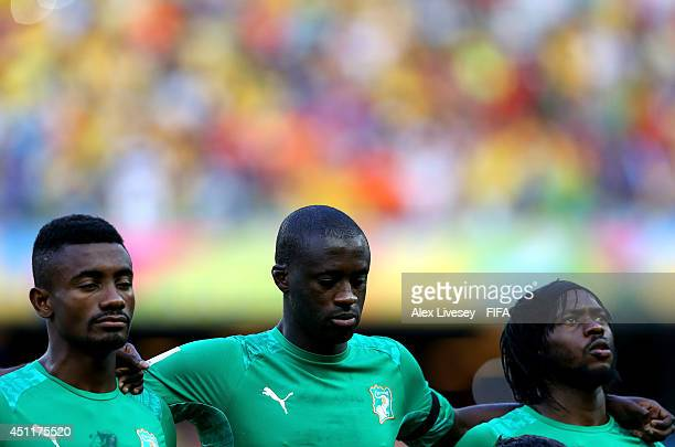 Salomon Kalou Yaya Toure and Gervinho of the Ivory Coast look on during the National Anthem prior to the 2014 FIFA World Cup Brazil Group C match...
